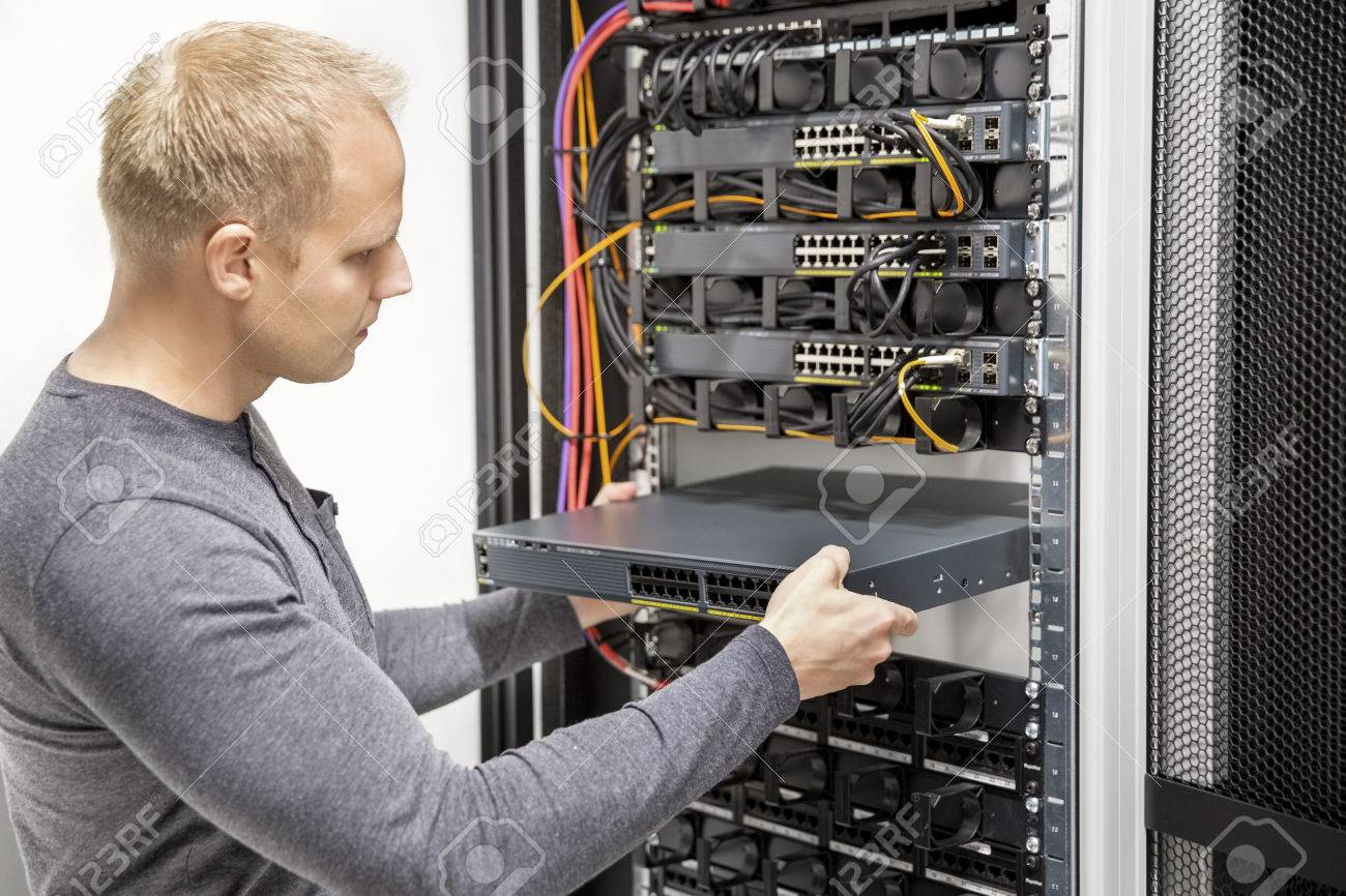 IT consultant build network racks in datacenter Stock Photo - 32777132