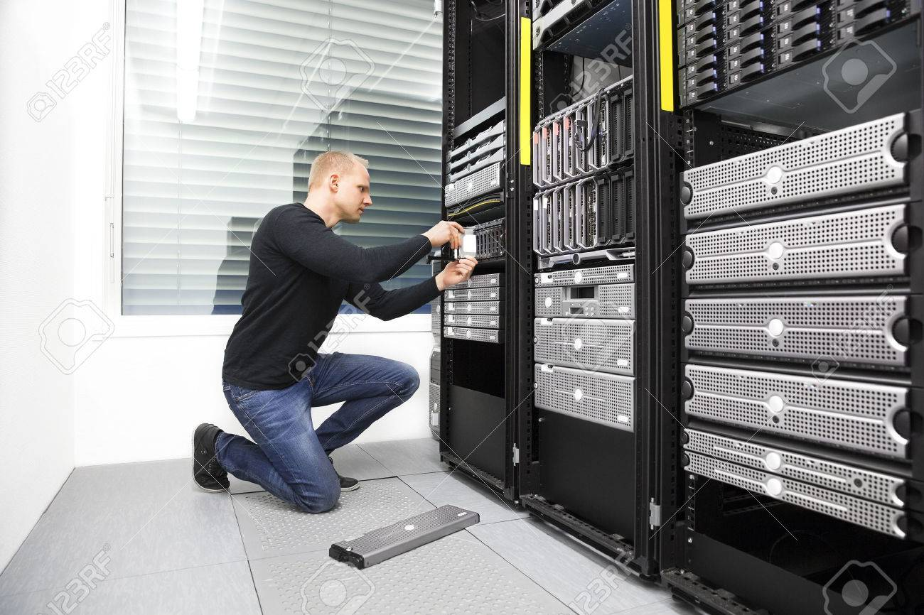 It consultant replace harddrive in datacenter Stock Photo - 38644187