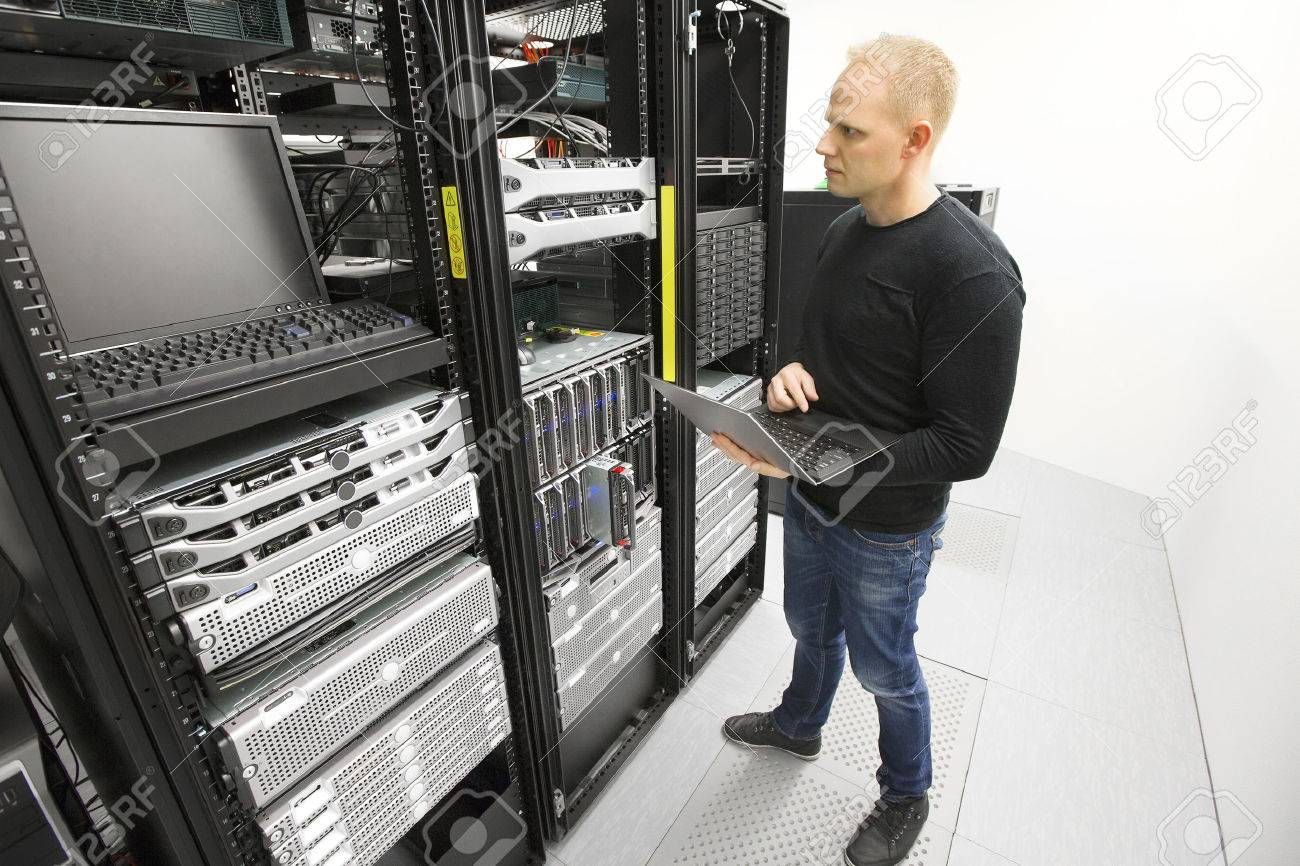 It consultant monitors servers in datacenter Stock Photo - 38781497
