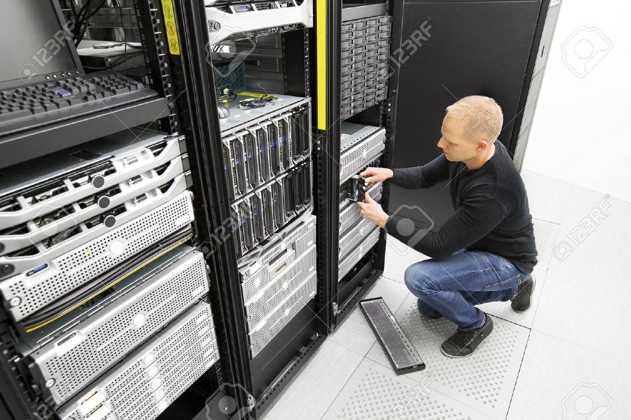 It engineer replace harddrive in datacenter Stock Photo - 39098560