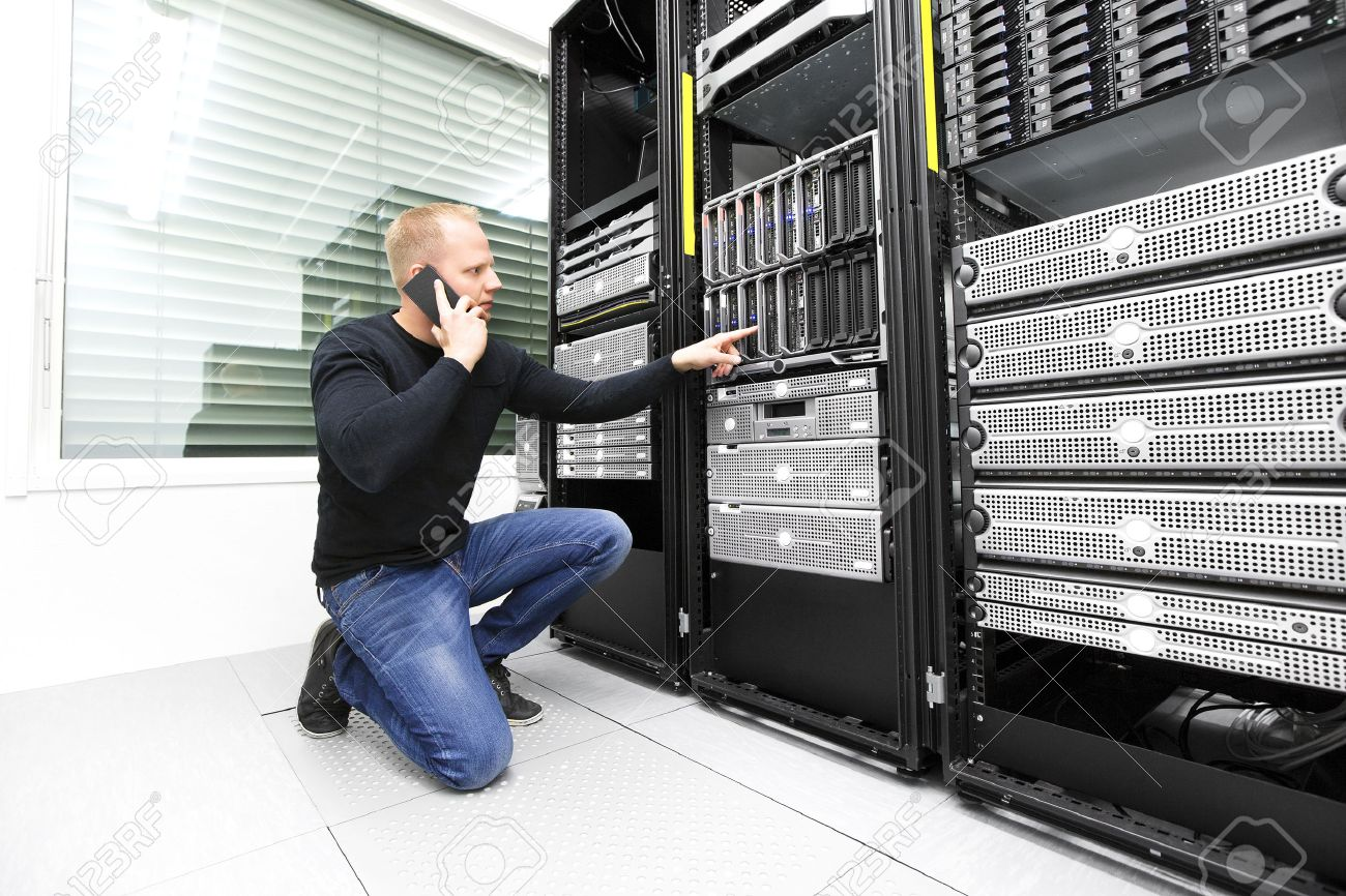 IT consultant calling support in datacenter Stock Photo - 39591320