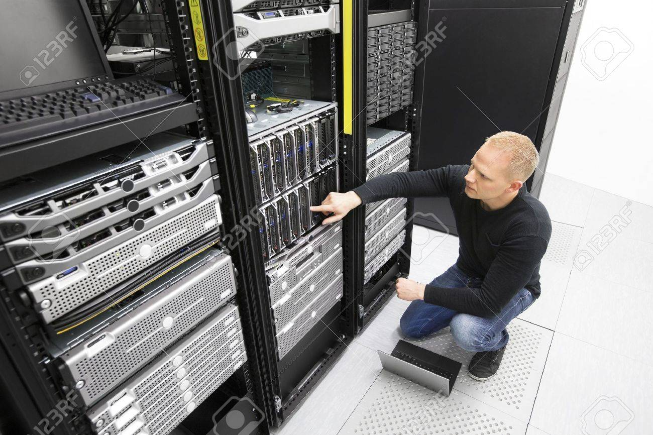 It consultant monitors servers in datacenter Stock Photo - 40968912