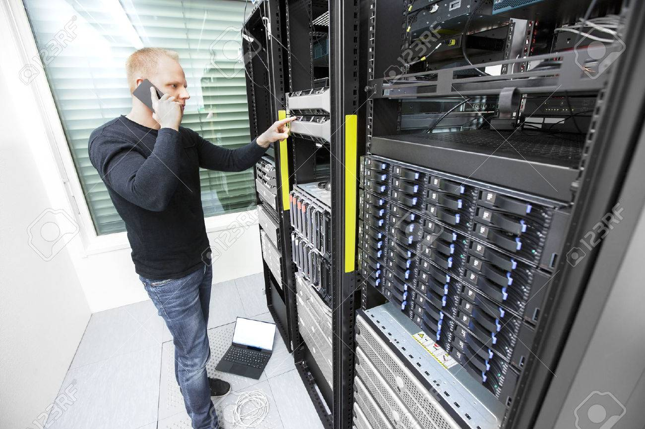 It engineer or technician monitors and solving problems with blade servers in data rack. Shot in datacenter. Stock Photo - 47171371