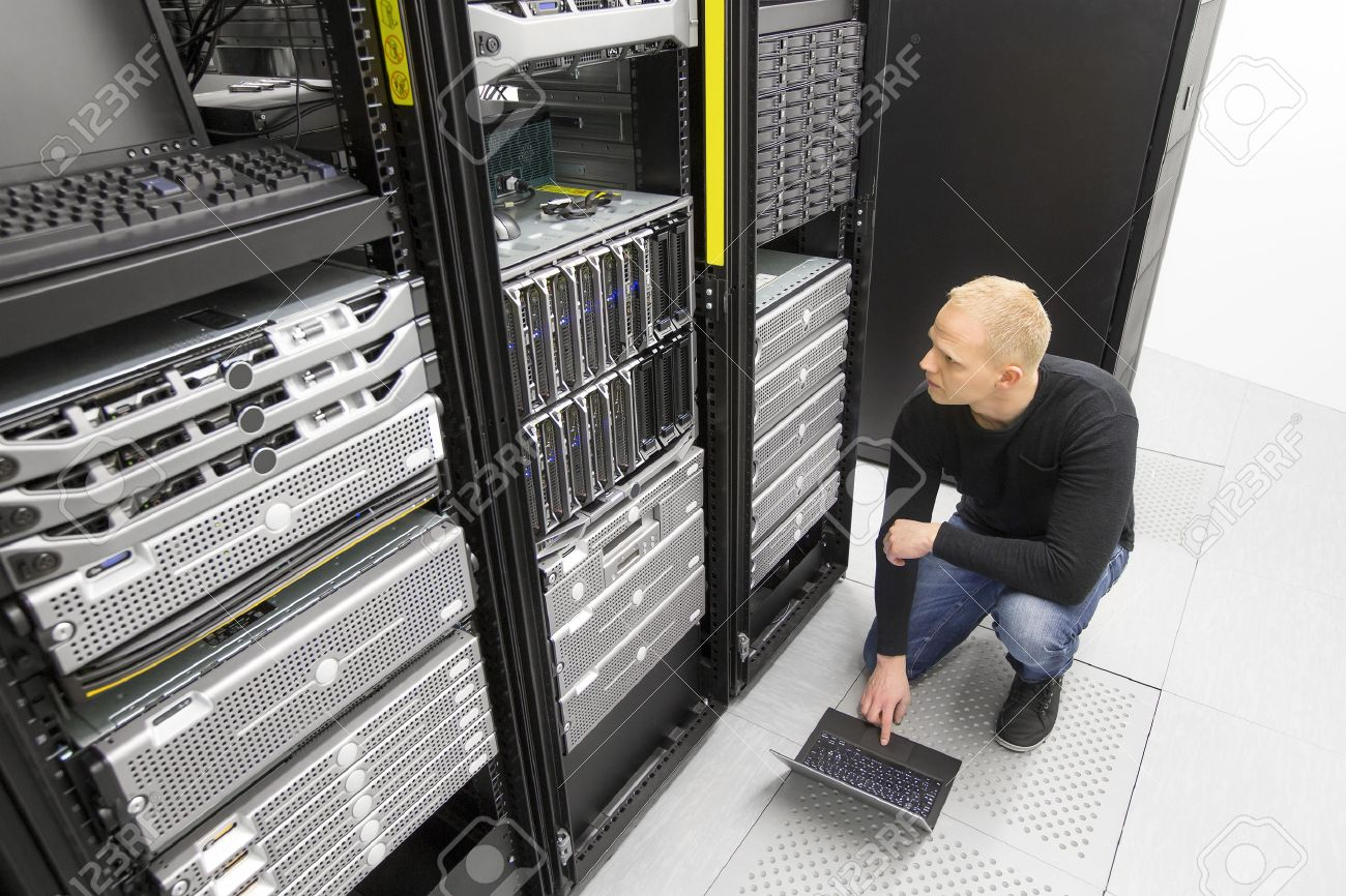 It engineer or technician monitors blade servers in data rack. Working in datacenter. Stock Photo - 48646433