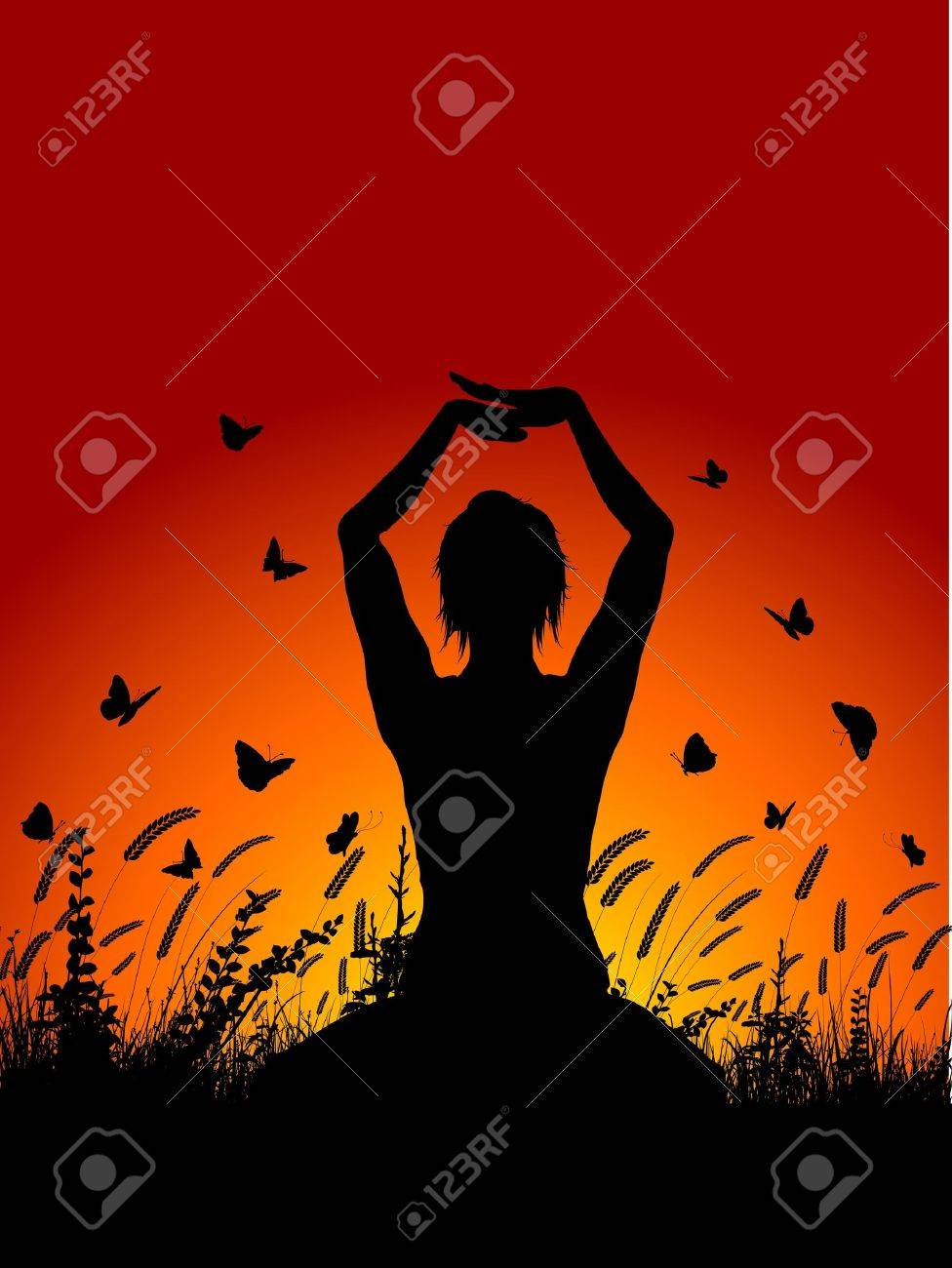 Silhouette of a female in a yoga pose against a sunset sky with butterflies flying around Stock Photo - 9478703
