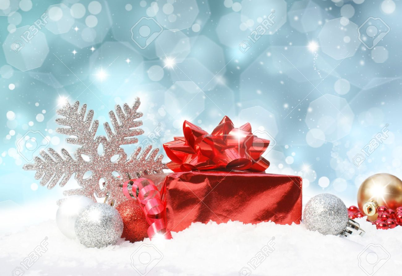 Glittery blue Christmas background with decorations in snow Stock Photo - 9920037