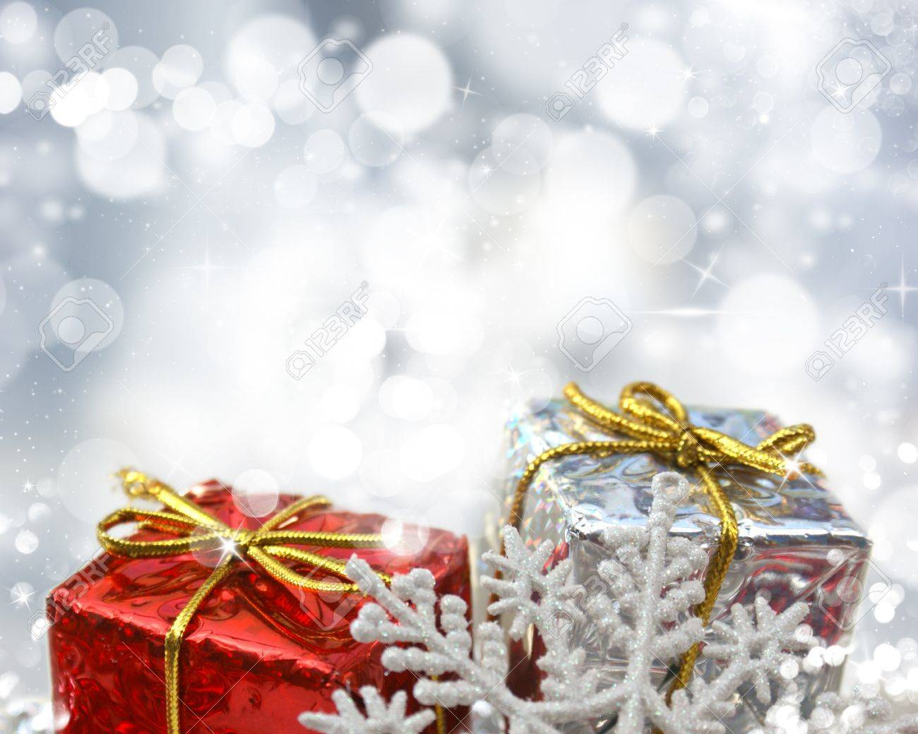 Christmas Gifts On A Silver Bokeh Lights Background Stock Photo ...