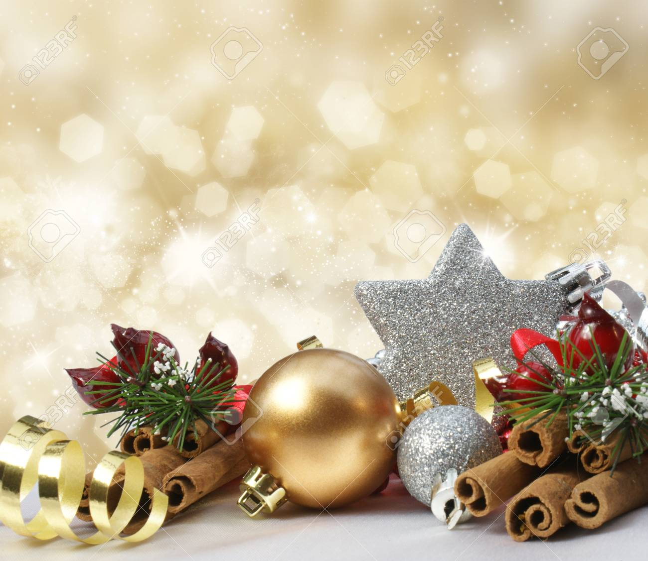 Christmas decorations on a glittery gold background Stock Photo - 16446590
