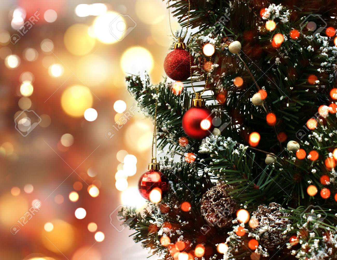 Christmas Tree With Decorations On A Bokeh Lights Background Stock ...