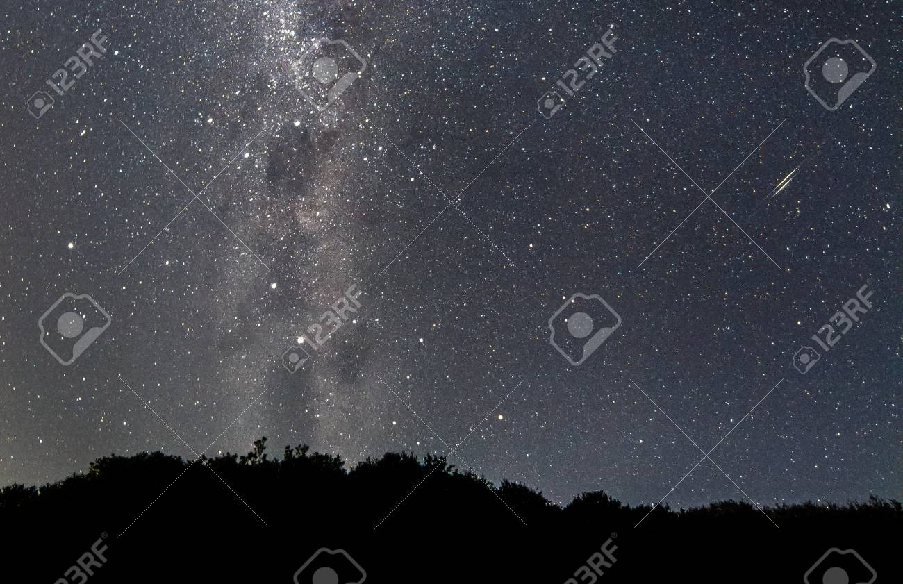 A pair of shooting stars streak across the night sky as seen from the Wilsons Promontory National Park, Victoria, Australia. - 104036286