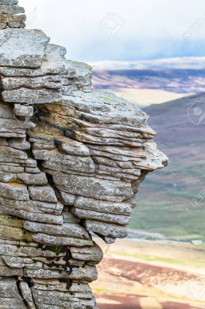 Rock layers smoothed by years of weathering are seen near the summit of Pen-y-Ghent in the Peak District, England. - 120581707