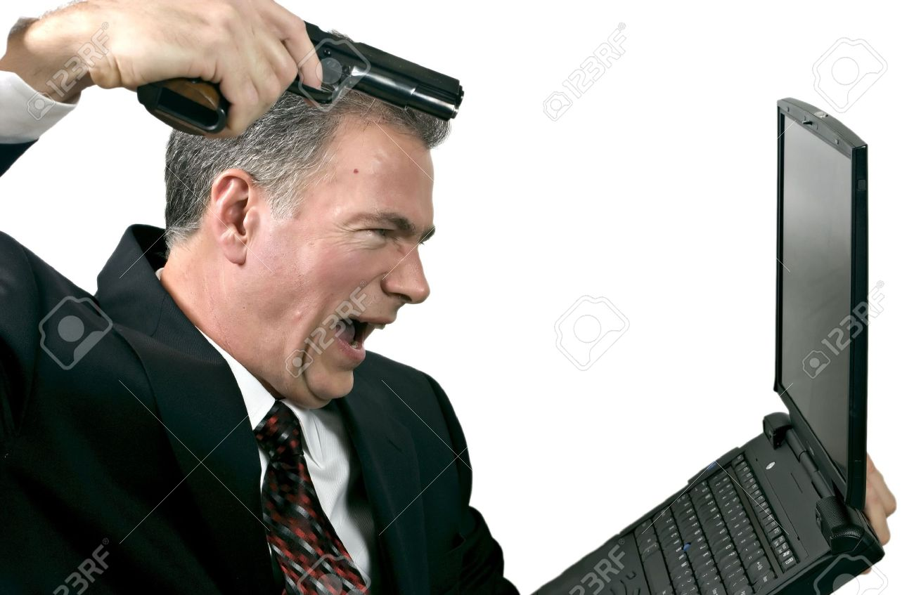 Man furious with his bad stock trades taking it out on his computer by shooting at it. Stock Photo - 1230709