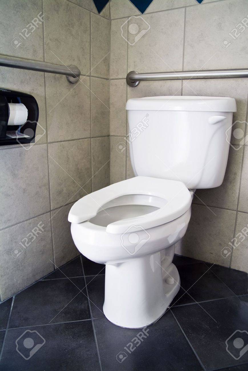 A Picture Of A Commode With No Lid And Handicap Accommodations ...