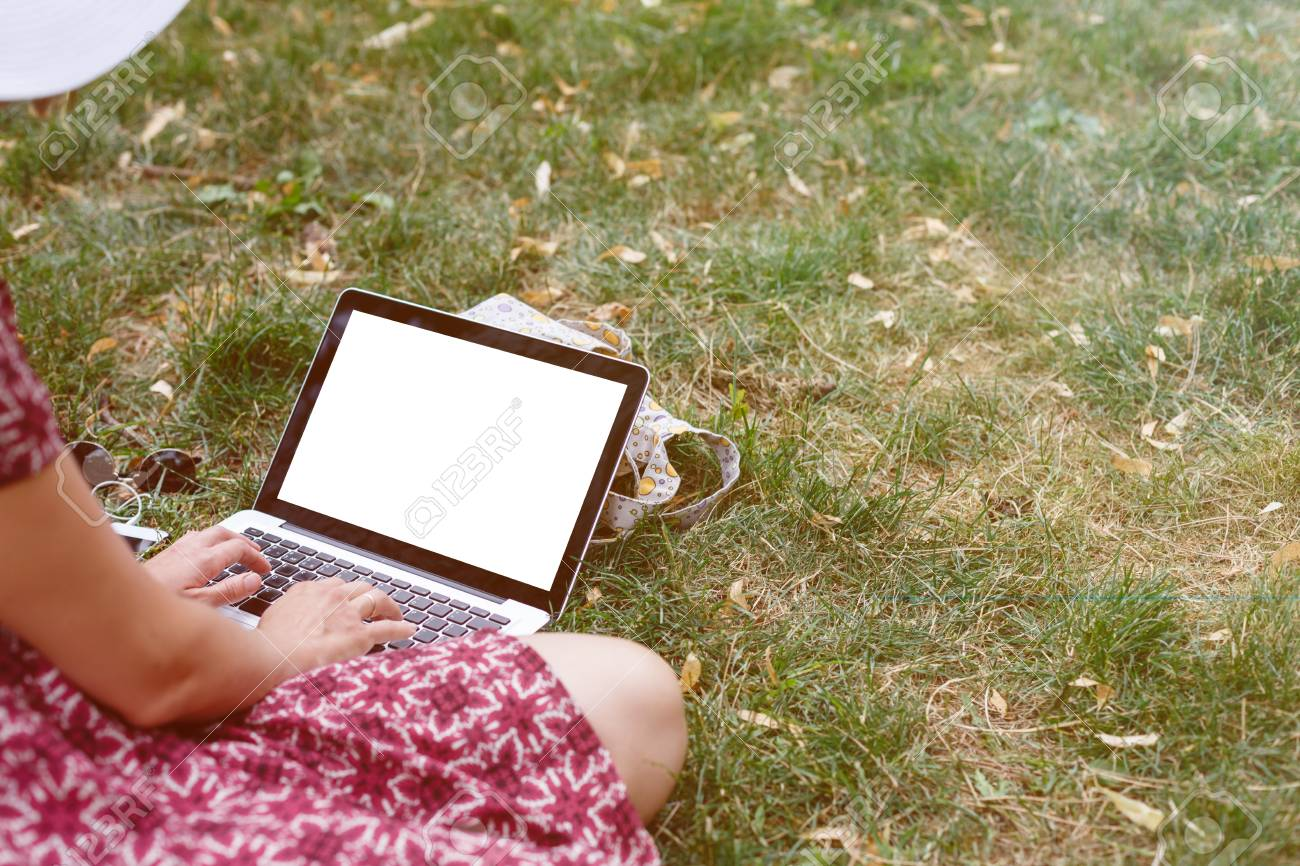 Crop Mockup Shot From Above Of Casual Girl Sitting On Lawn