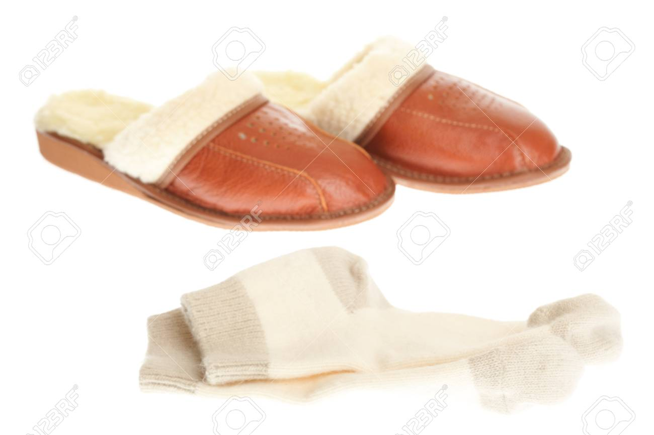 8f0f092a834 brown wool comfortable slippers and thick woollen socks - house slipper  isolated on white background Stock