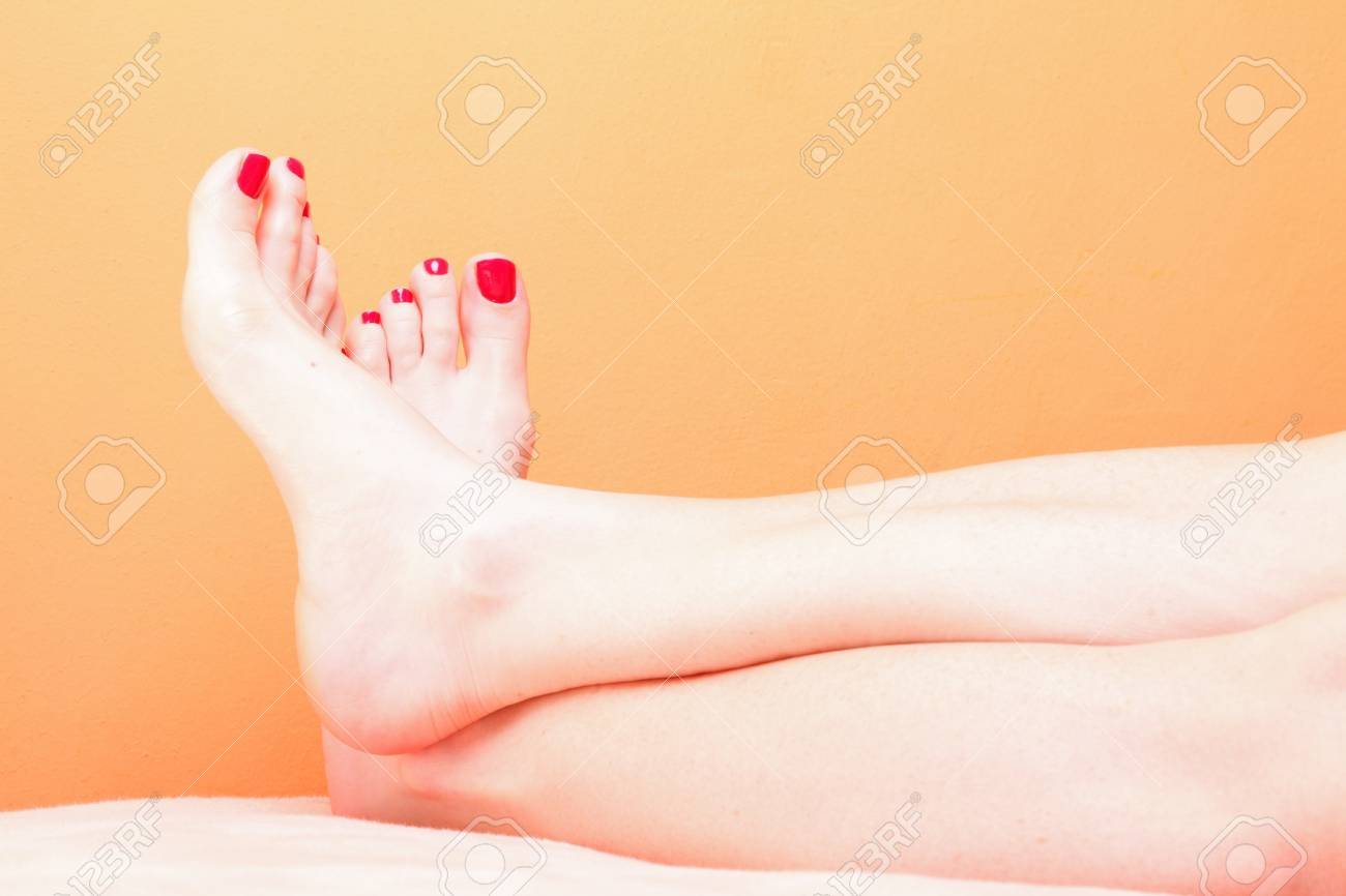 woman feet with red toenails on pink towel Stock Photo - 11917506