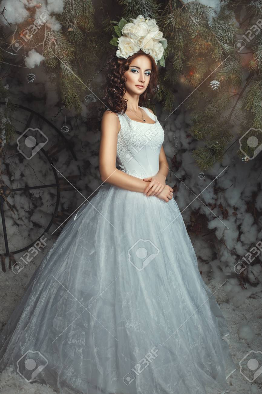 Woman In A Wedding Dress On The Head With Decoration Of Flowers ...