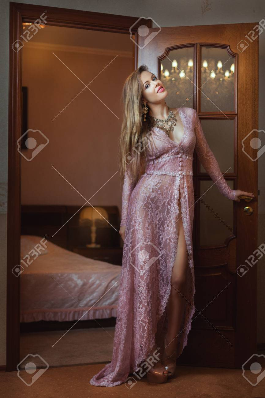 Girl In Peignoir Standing Near The Door To The Bedroom Stock Photo Picture And Royalty Free Image Image 64065178