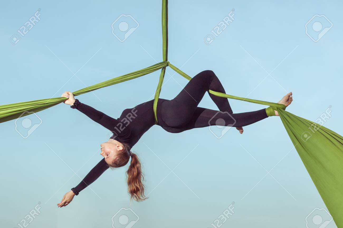 woman the air equilibrist carries out tricks on a hammock  stock photo   85359860 woman the air equilibrist carries out tricks on a hammock  stock      rh   123rf