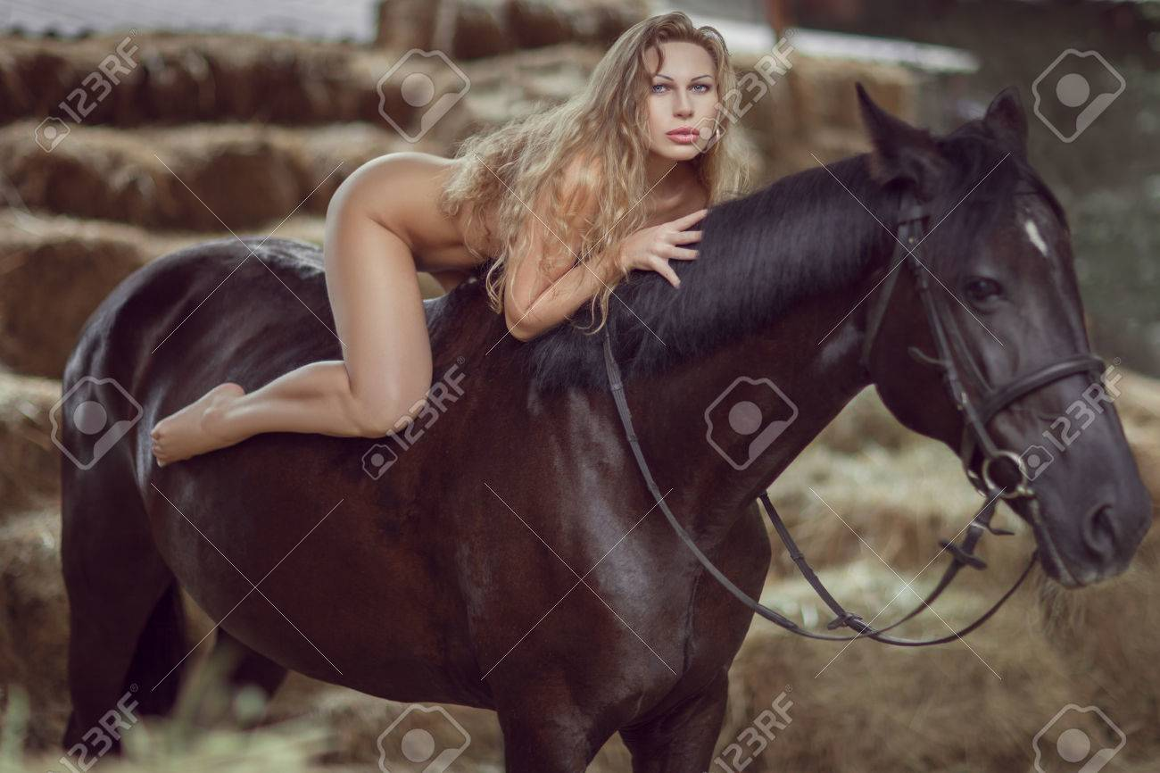 Actress Porn Hair Horse young naked woman is covered with long hair, she is riding a..