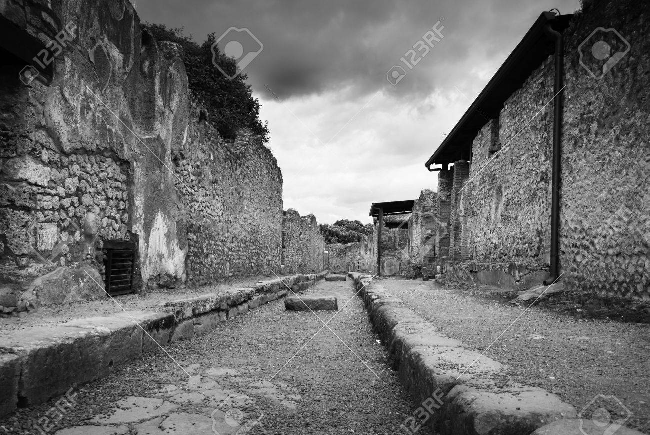 Rare empty street in pompeii italy black and white