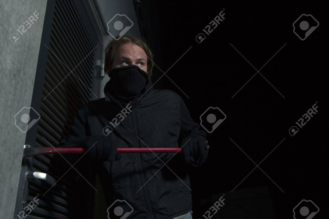 man with crowbar Stock Photo - 13954720