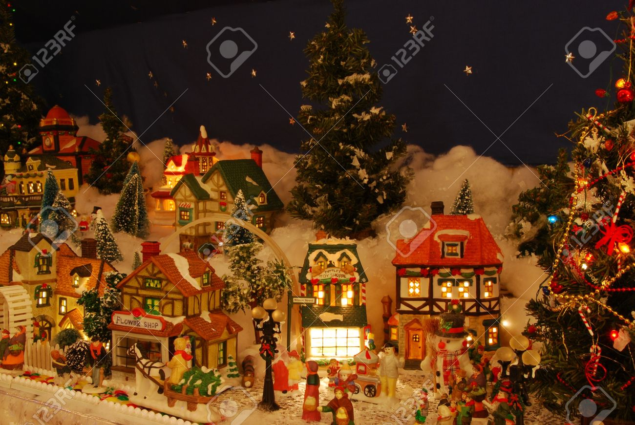A Miniature Christmas Village Is All Lit Up. The Little People ...