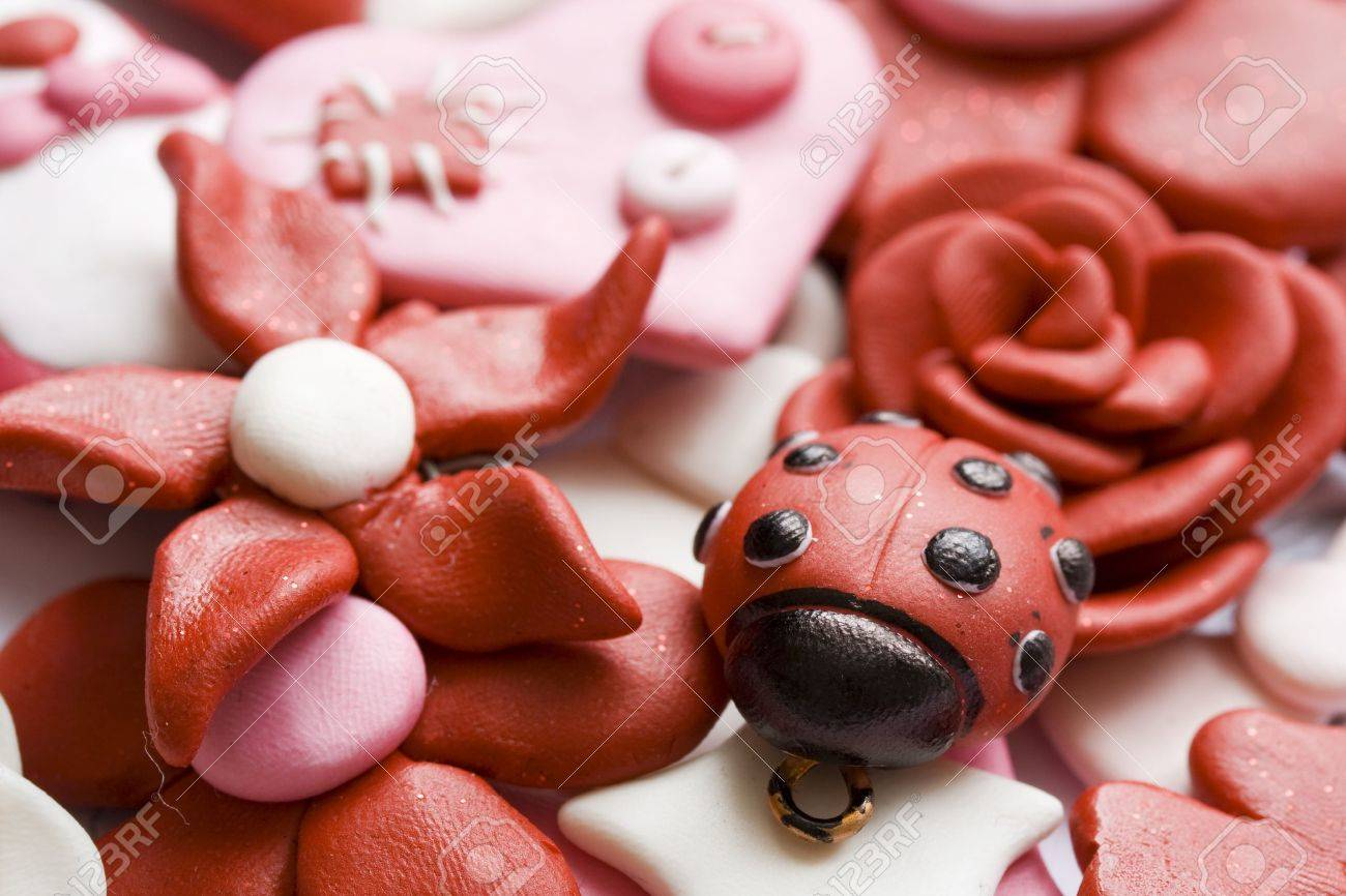 Macro shot of various pink and happy decorations made from clay. - 6439891