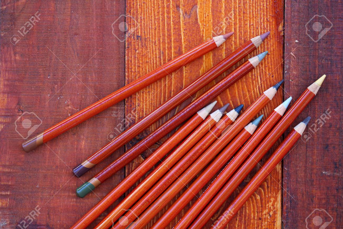 Colored Pencils on wooden background - 43815931