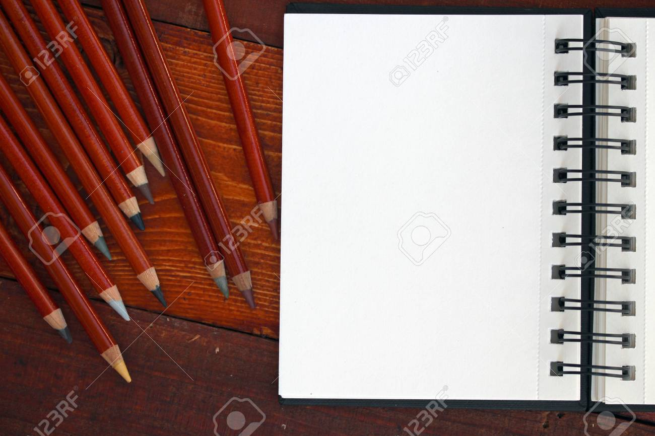 Blank Notebook and Colorful Pencils - 43815939