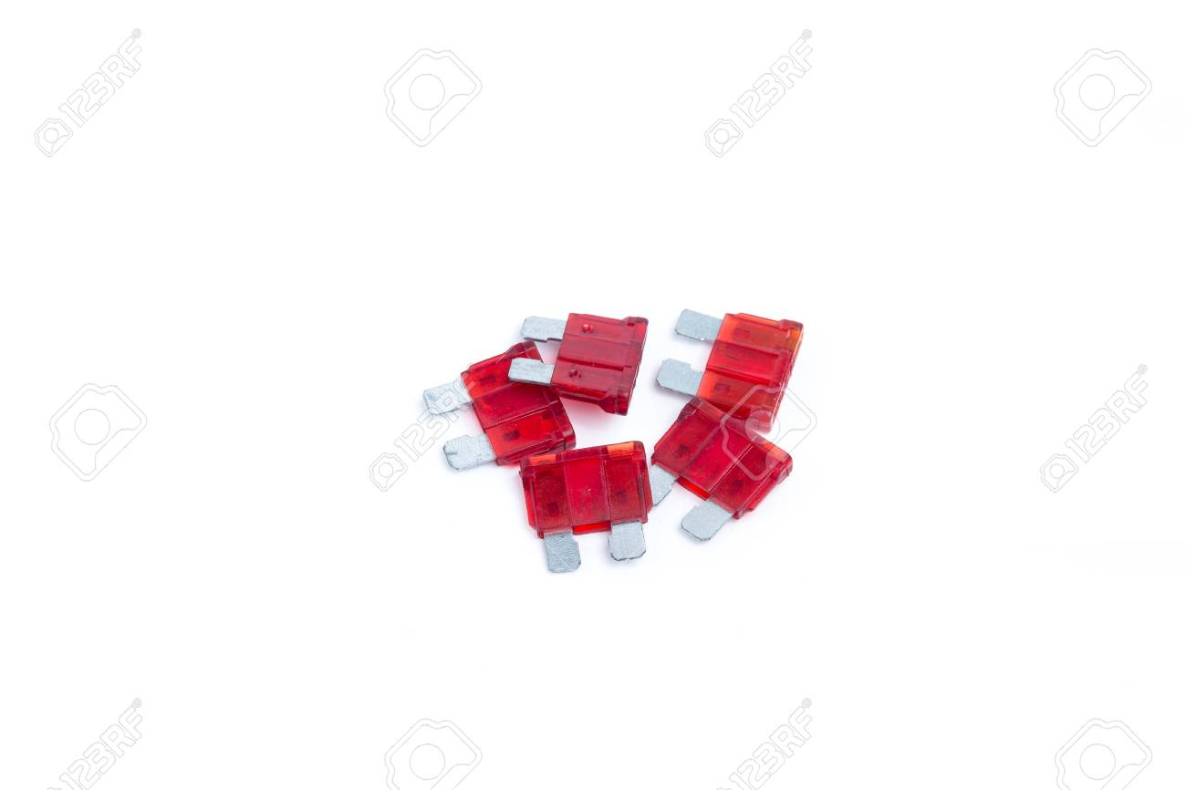 Car fuse  Pile of red electrical automotive fuses or circuit