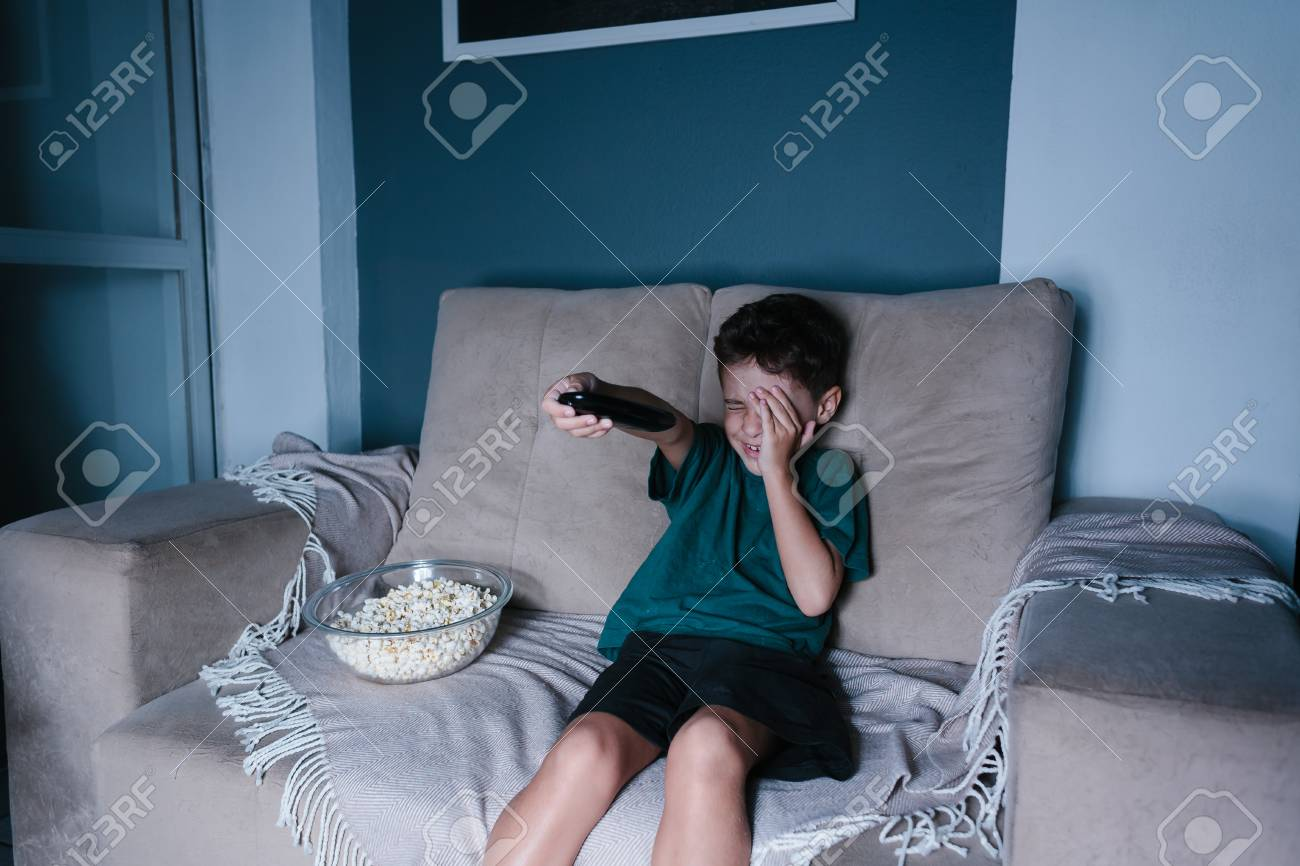Amazing Scared Child Watching Scary Movie On Tv Sitting On The Couch Download Free Architecture Designs Scobabritishbridgeorg