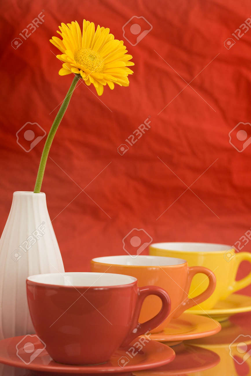 Row of color cups and beautiful yellow gerbera. Selective focus. Stock Photo - 2585709