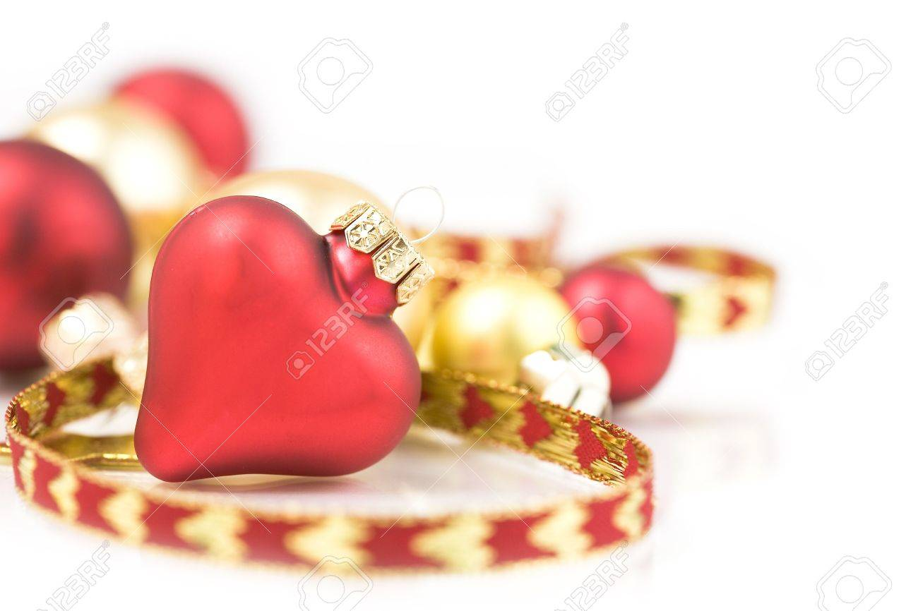 Red and gold christmas ornaments - Red And Gold Christmas Ornaments On White Background Stock Photo 3864520