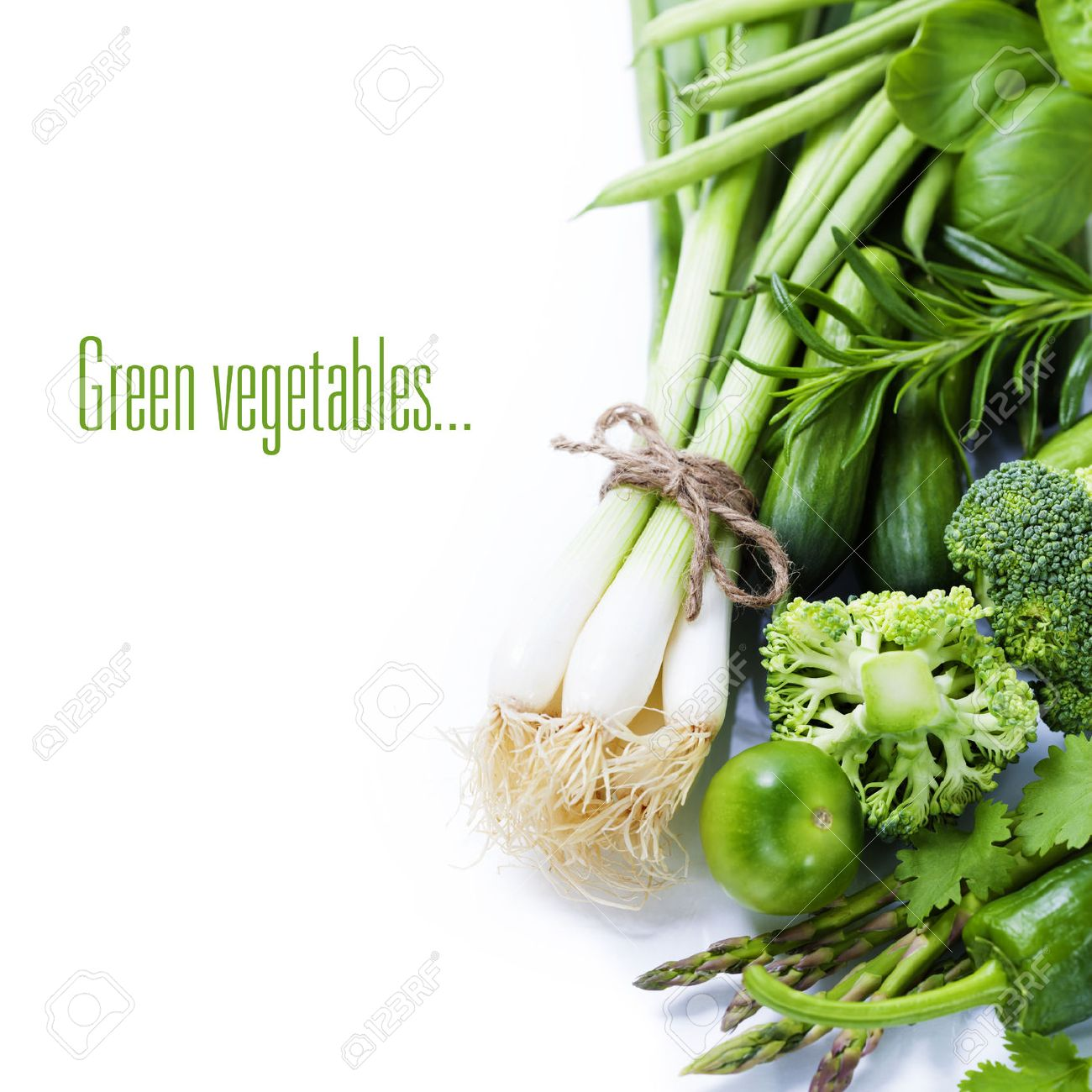 fresh green vegetables on white background (with easy removable sample text) - 23302173