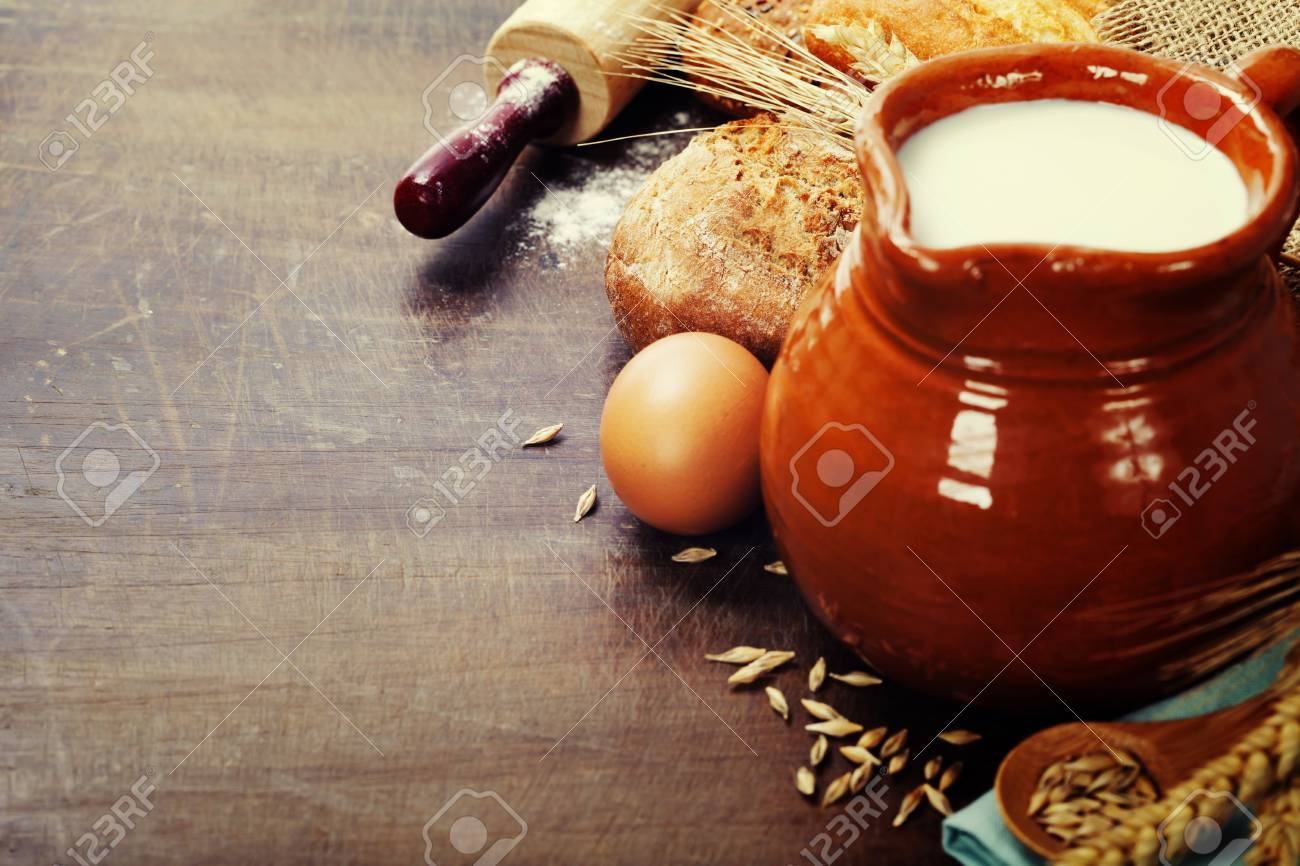 Freshly baked traditional bread and milk on wooden table Stock Photo - 23651502