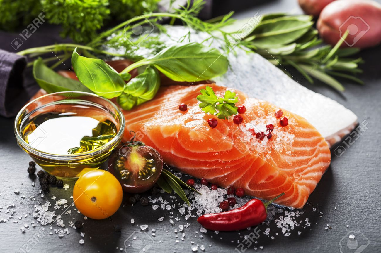 Delicious portion of fresh salmon fillet with aromatic herbs, spices and vegetables - healthy food, diet or cooking concept - 29035581