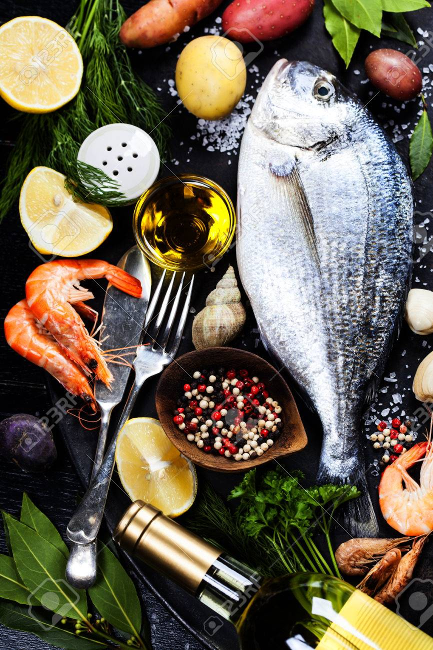 Delicious Fresh Fish And Seafood On Dark Vintage Background ...