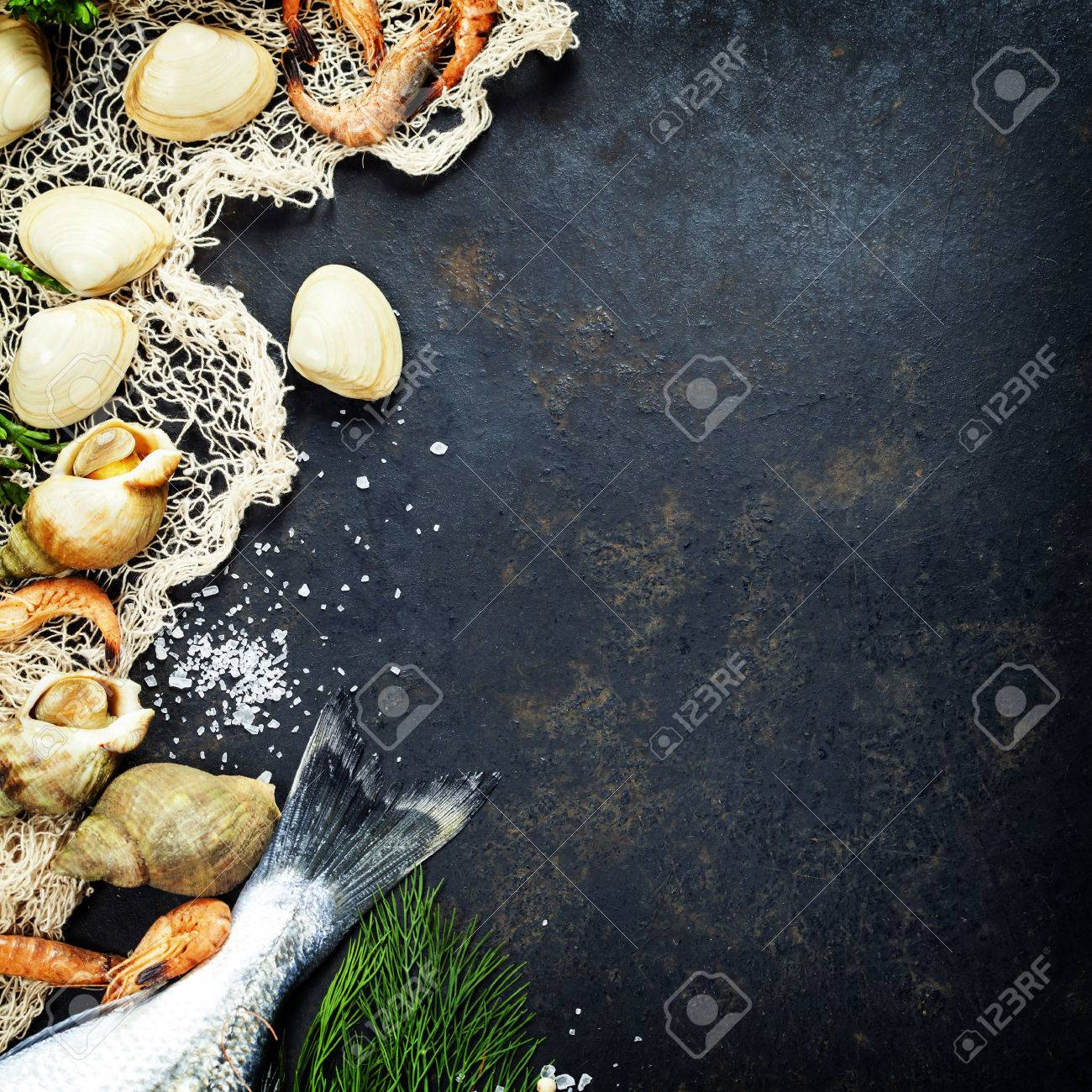 Delicious Fresh Fish And Seafood On Dark Vintage Background. Fish ...