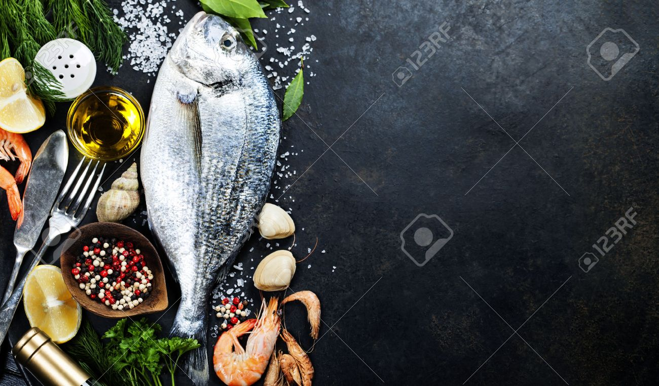 Delicious Fresh Fish On Dark Vintage Background. Fish With ...