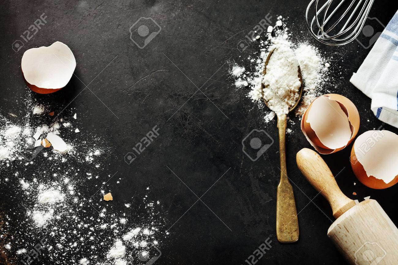 baking background with eggshell and rolling pin - 39221154