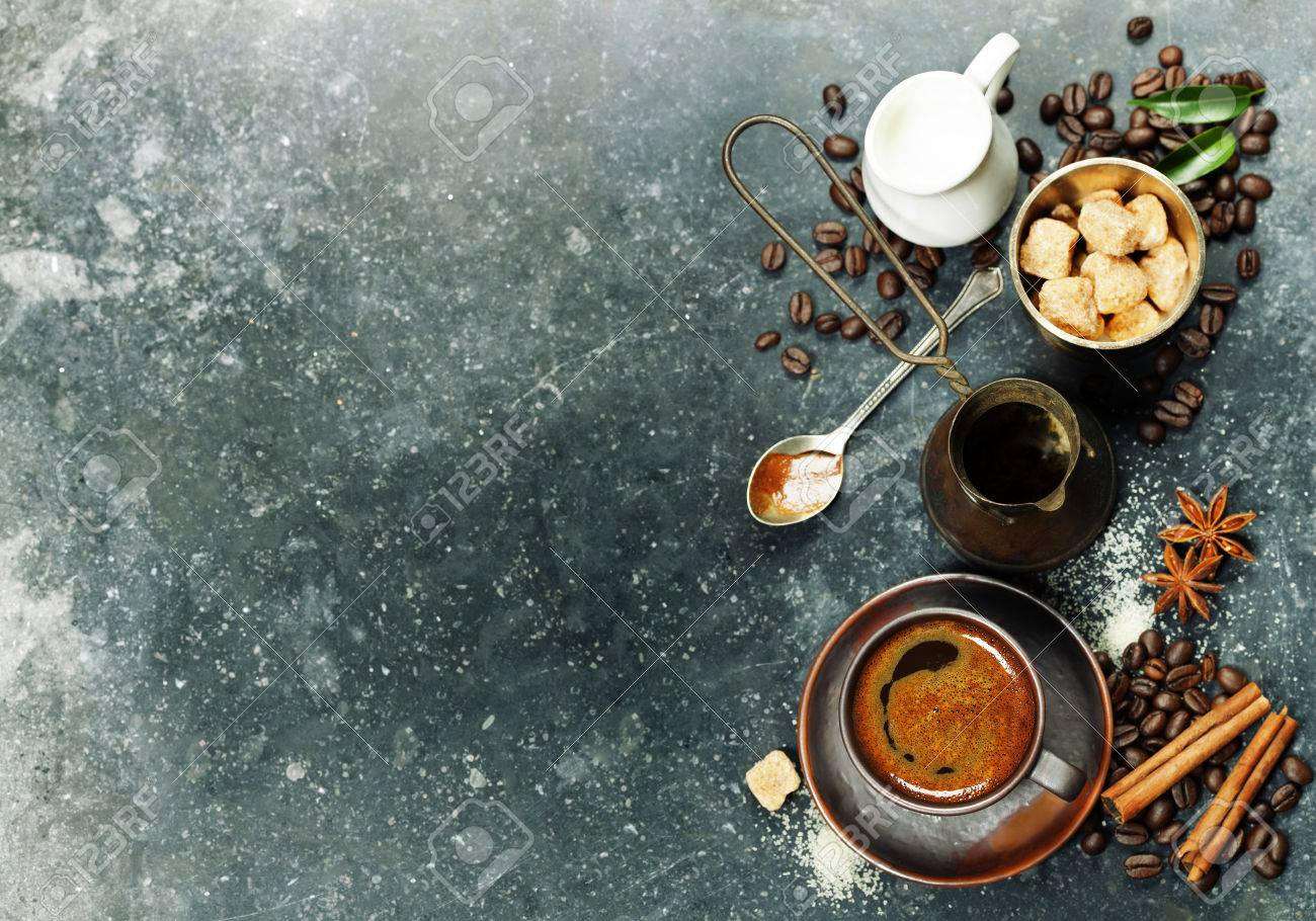 marble table top background. top view of espresso coffee, milk and sugar on black marble table. background with table a