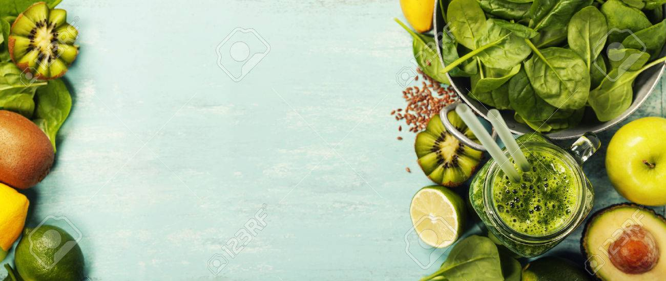 Healthy green smoothie and ingredients on blue background - superfoods, detox, diet, health, vegetarian food concept - 59803395
