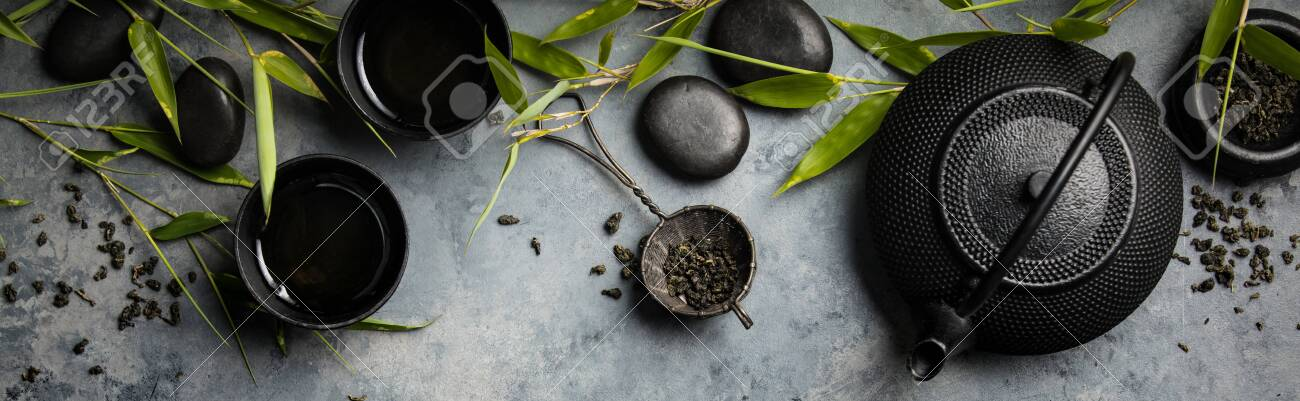 Bamboo branches and green tea on concrete background - 129350036