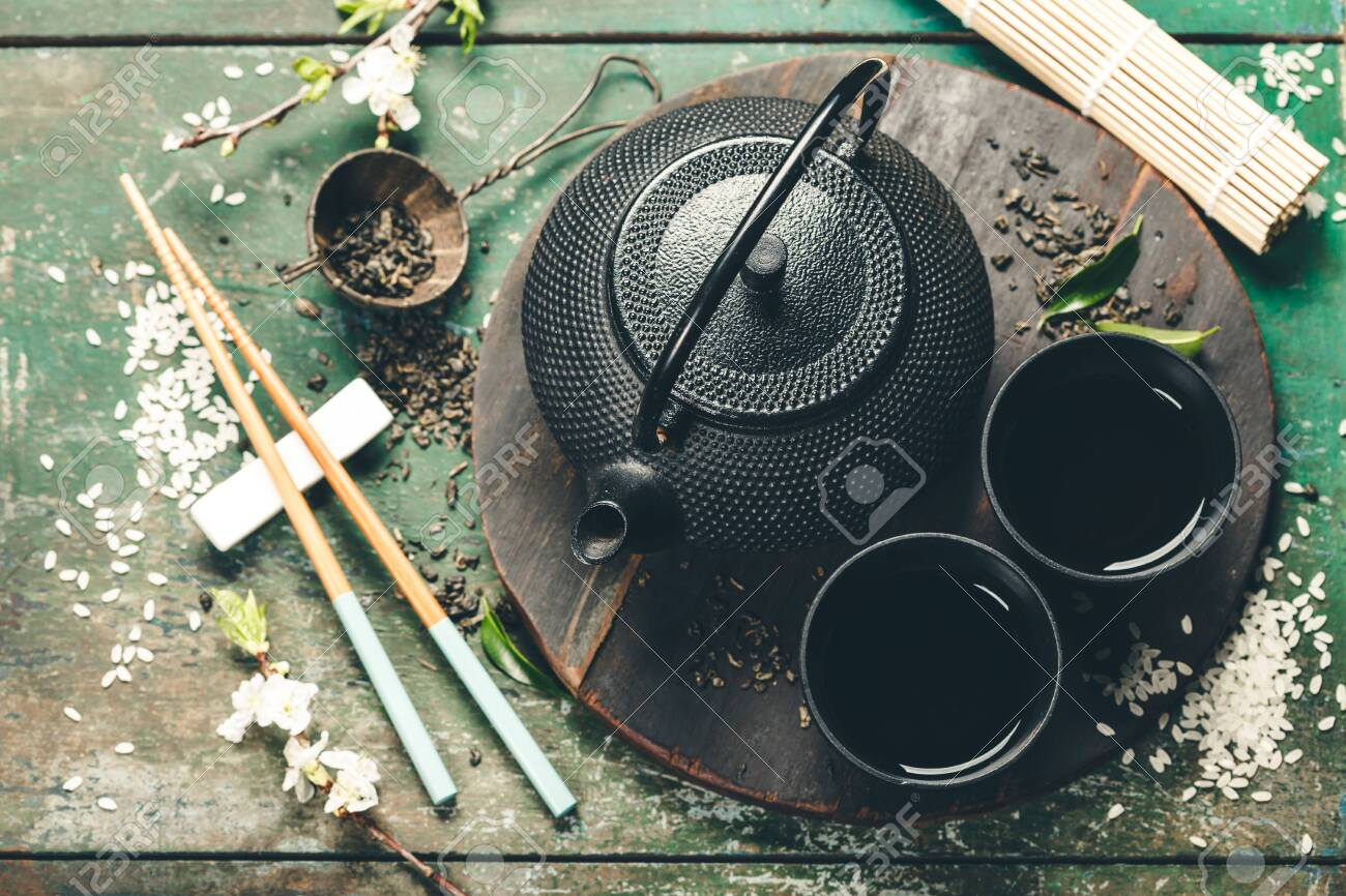 Chinese Tea Set and chopsticks on rustic wooden table - 152301178