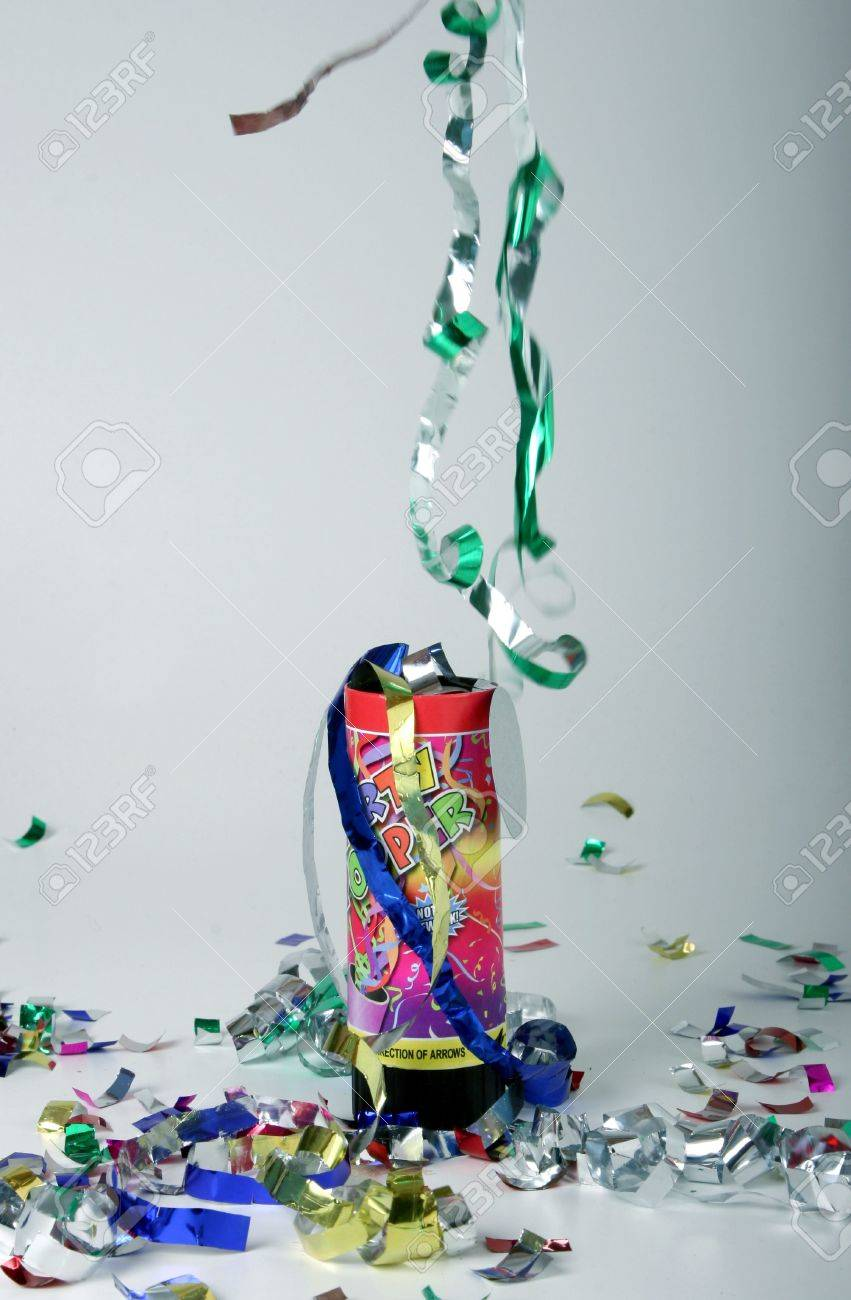 Colored confetti shooting up in the air from a party popper Stock Photo - 654959