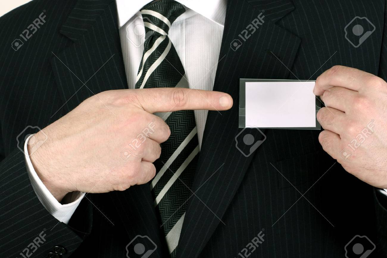 Business man showing his blank namebadge - insert your own brand and information Stock Photo - 858089