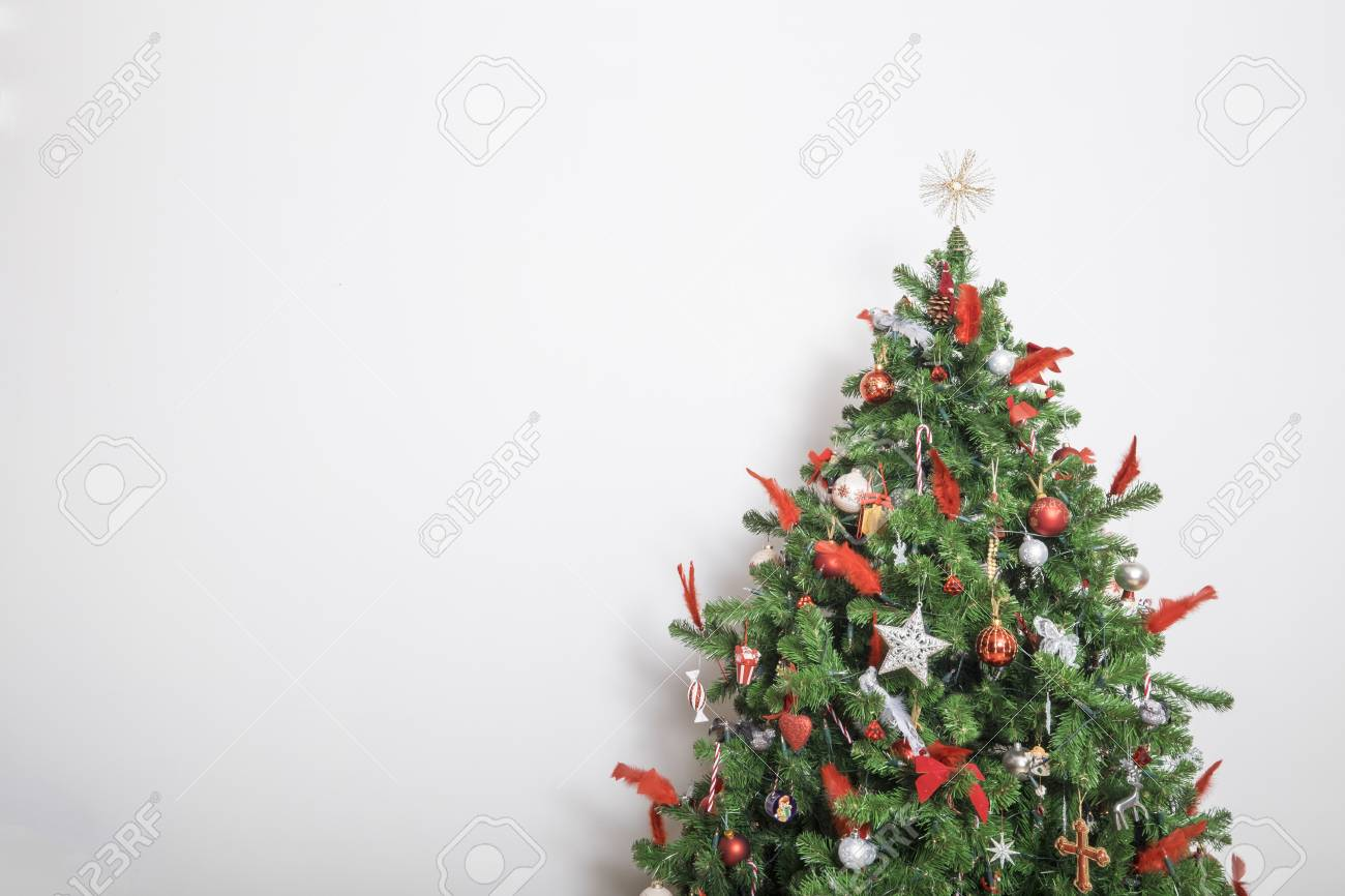 Beautiful Decorated Christmas Tree Against A White Wall Stock Photo Picture And Royalty Free Image Image 45634650