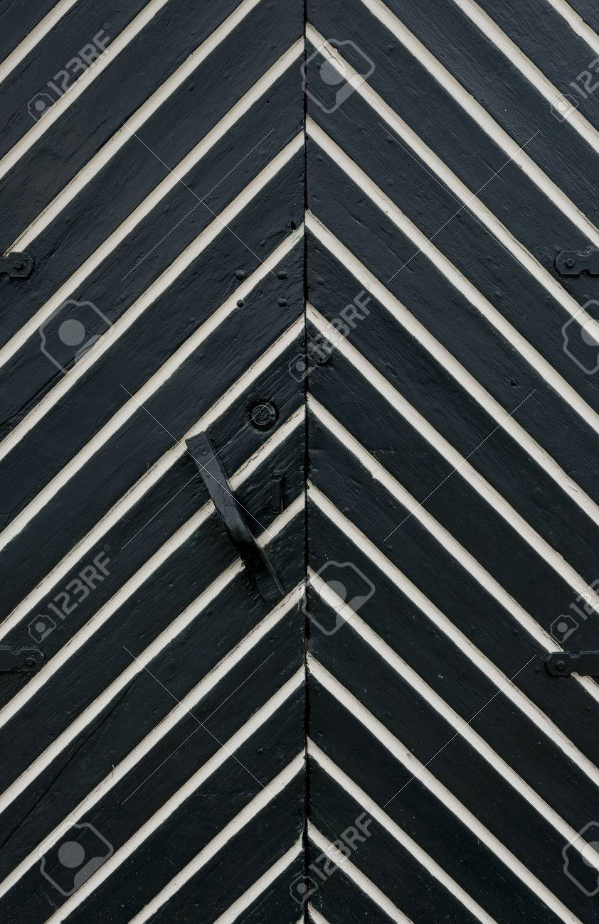 white and black door with fish bone pattern stock photo picture