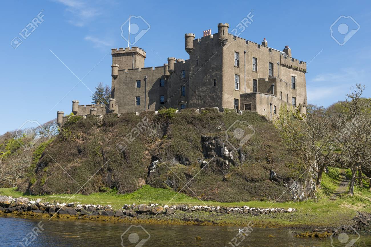 Castle Dunveganat And Garden At The Blue Ocean On The Isle Of ...